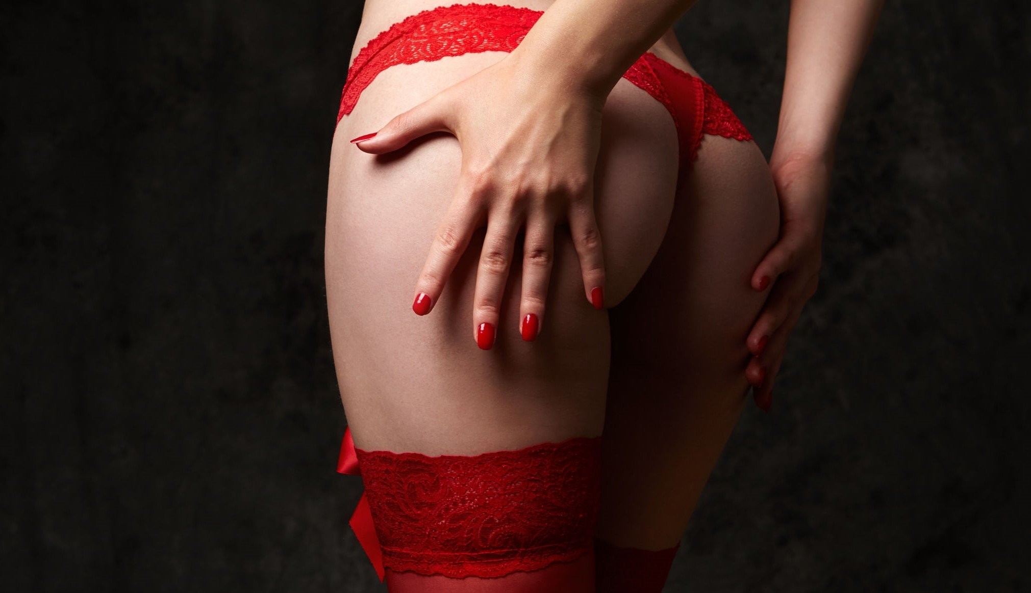 woman hand on bottom red lingerie