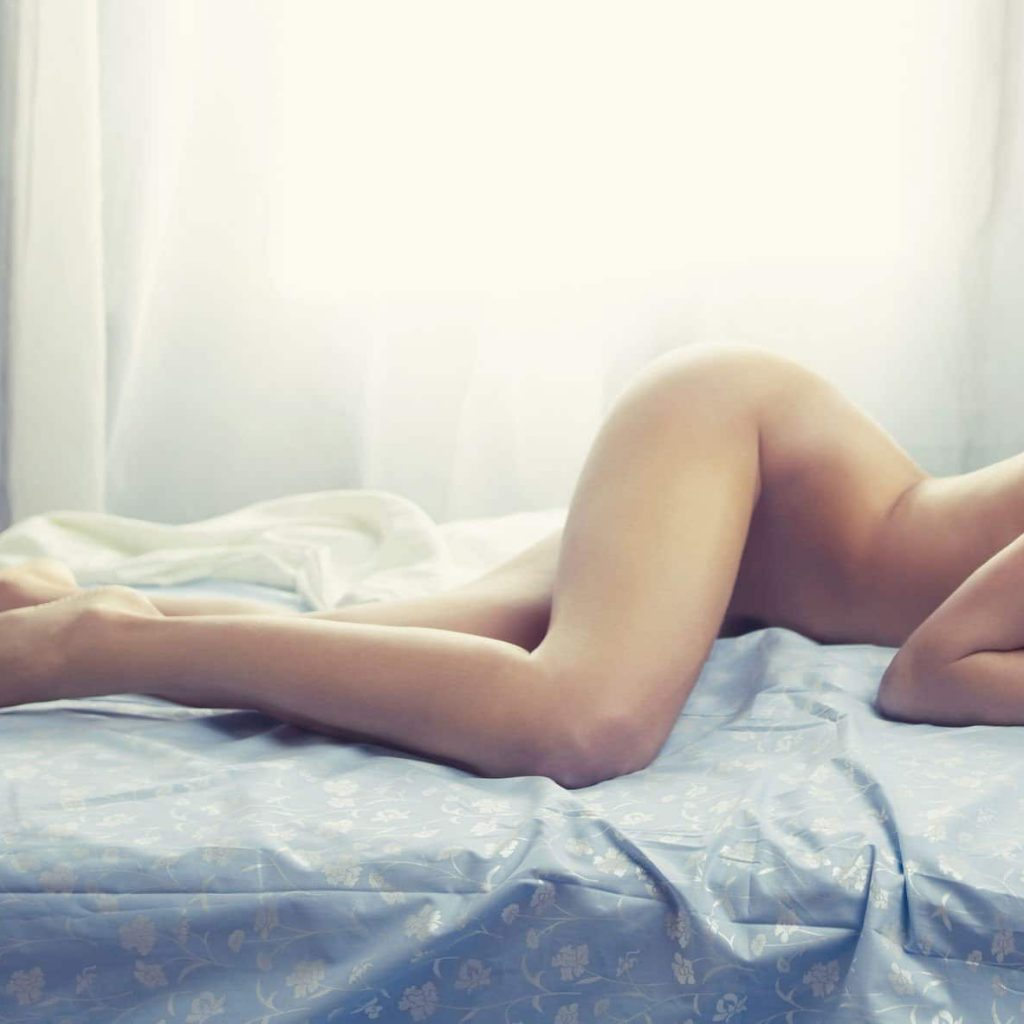 open window curtain woman laying on white bed naked