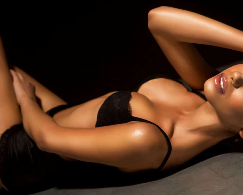 Tanned model laying down