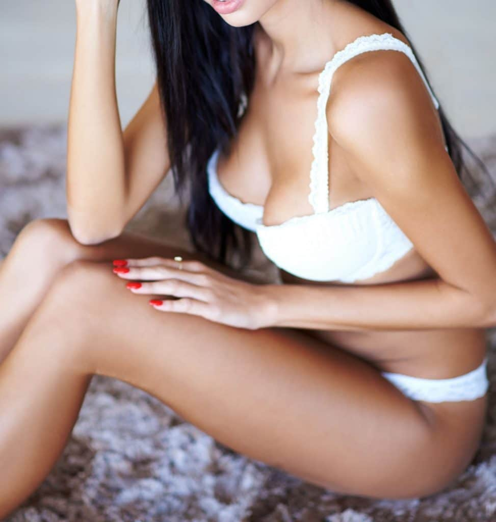 Long legs black hair beautiful exotic woman in lingerie