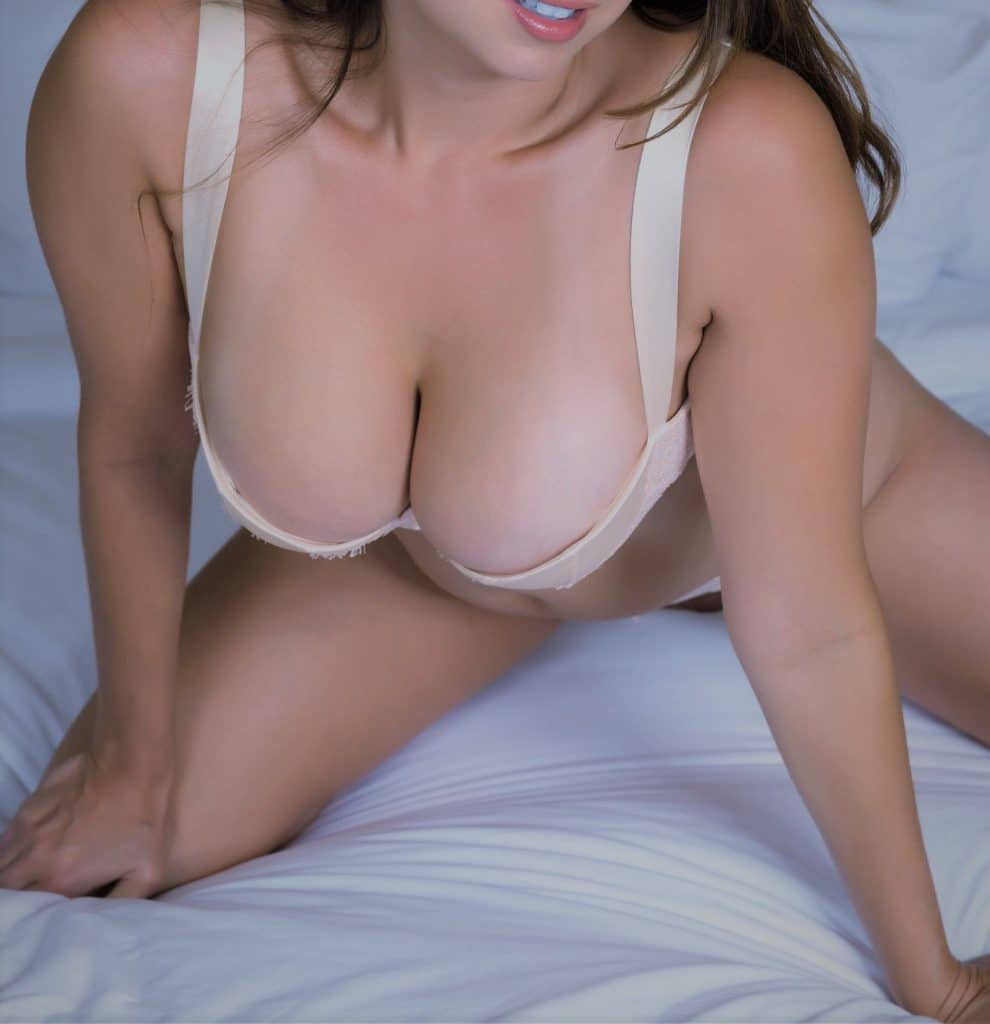 Sexy curvy busty woman on bed