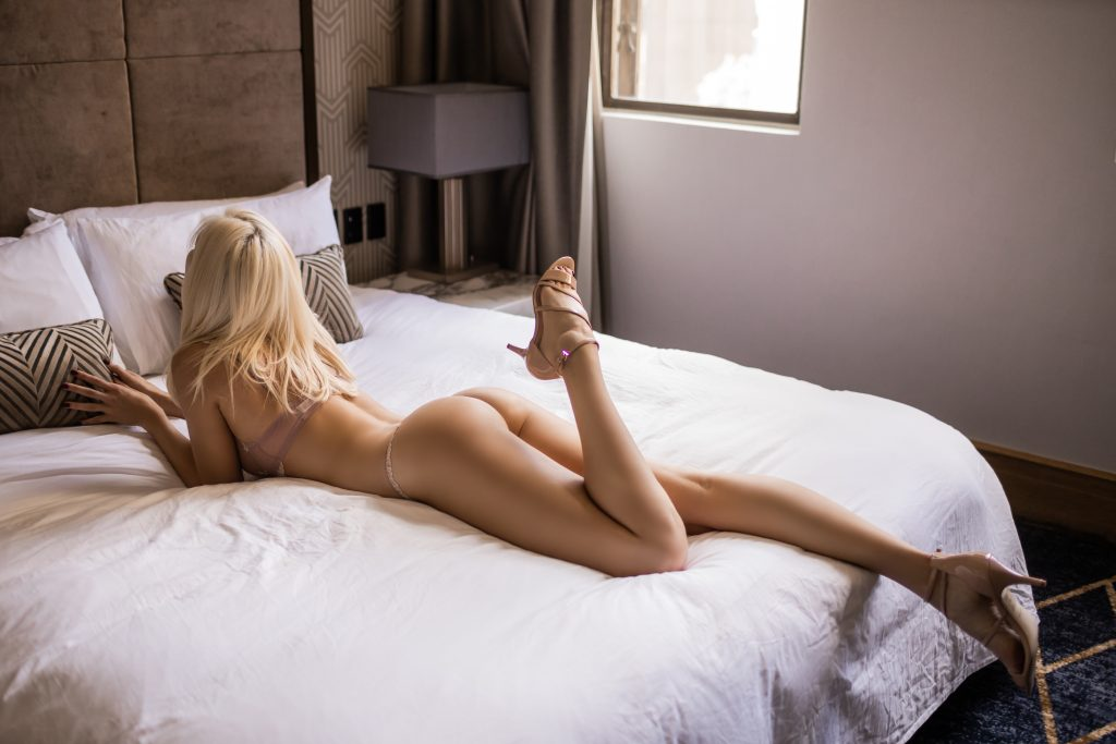 Giselle naked blonde woman lying on bed