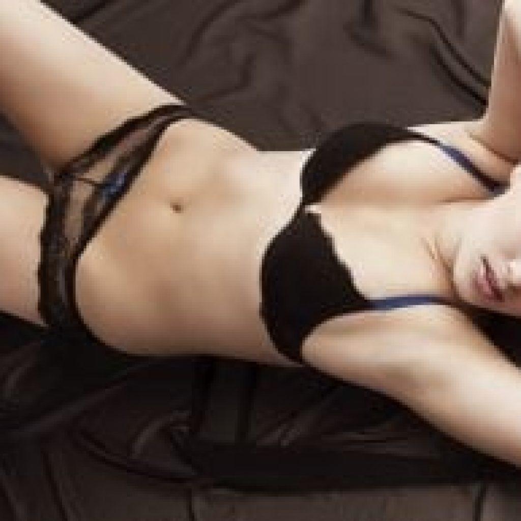 Mia Sexy woman lying down